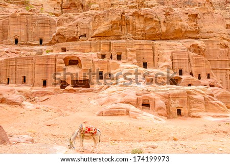 The cave of tombs in the ancient Jordanian city of Petra, Jordan.  It is know as the Loculi. Petra has led to its designation as a UNESCO World Heritage Site. - stock photo