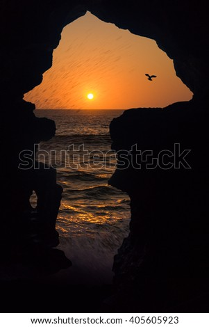 The Caves of Hercules is one of the most popular tourist attractions near Tangier, north of Morocco, representing the map of Africa. - stock photo