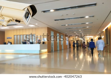The CCTV Security Camera operating in hospital blur background. - stock photo