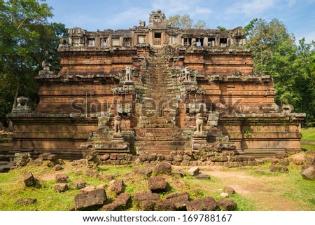 The celestial temple Phimeanakas from 11th century is part of the royal palace Angkor Thom at the cambodian Angkor Wat heritage site - stock photo