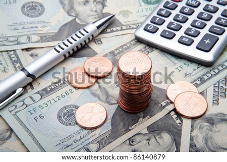 the 1 cent coins on banknotes background - stock photo