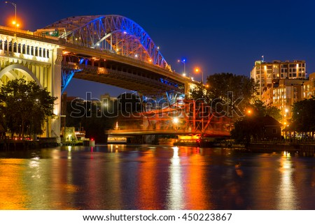 The Center Street Swing bridge moves back into place over the river after allowing a boat to pass, with motion blur from the movement - stock photo