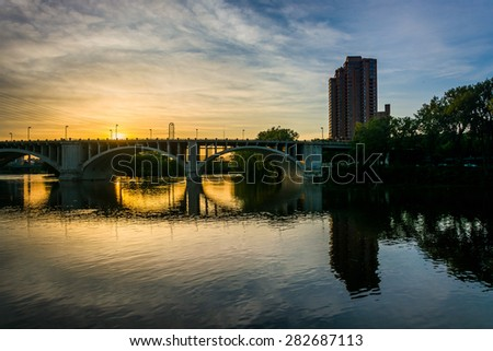 The Central Avenue Bridge and Mississippi River at sunset, in Minneapolis, Minnesota. - stock photo