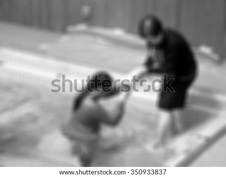 The ceremony was baptized background blurred black and white. person christ babies priest baptism religion mature emotions child candle water indoors image christianity events new Birth victory death - stock photo