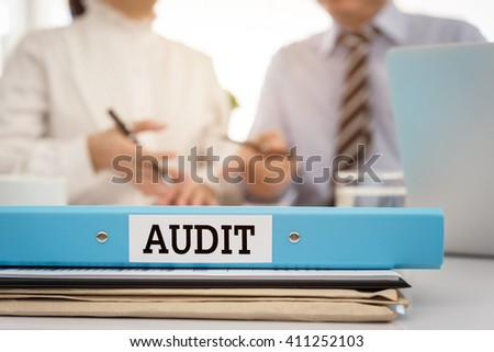The certification document file of financial statements with the auditor are providing advice to manager. Accounting audit concept. - stock photo