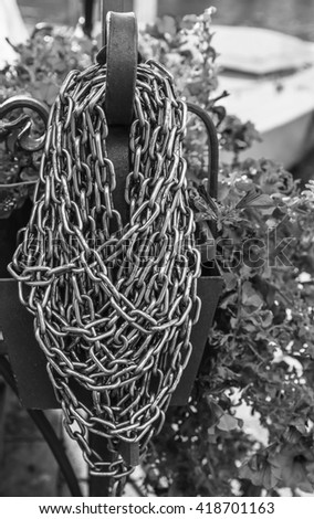 The chain at the marina in Venice . Black and white photography. - stock photo