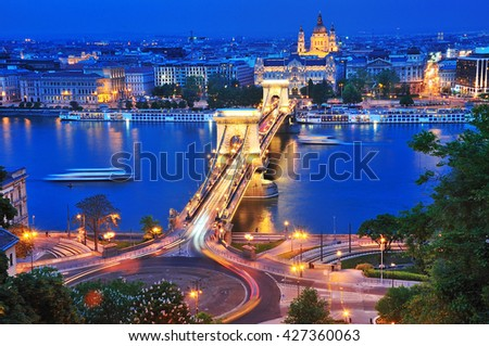 The Chain Bridge in Budapest in the evening. It is one of the symbolic buildings of Budapest, the most widely known bridge of the Hungarian capital. - stock photo