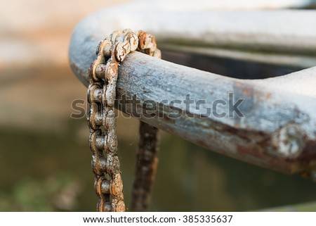 The chain used to lock the gear wheel that was used to pull the gate, not moving. - stock photo