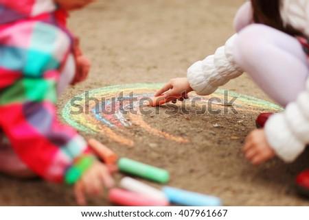 The chalk closeup a drawing to asphalt. - stock photo