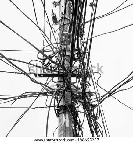 The chaos of cables and wires in Valparaiso - Chile (black and white) - stock photo