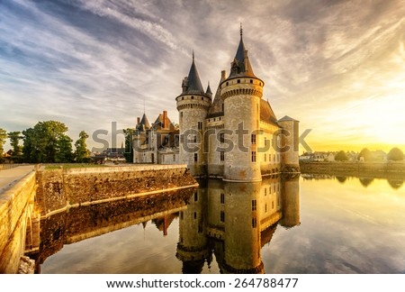 The chateau of Sully-sur-Loire at sunset, France. This castle is located in the Loire Valley, dates from the 14th century and is a prime example of medieval fortress. - stock photo