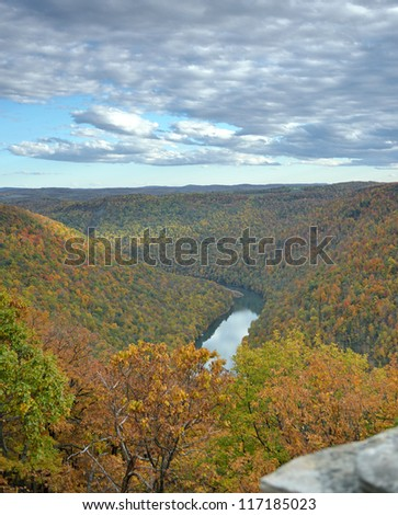 The Cheat River flows the the Cheat River gorge as seen from the Cooper's Rock State forest overlook in autumn. The park and gorge are located just east of Morgantown, West Virginia. - stock photo