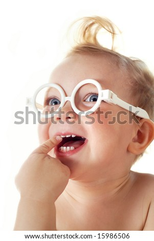 The cheerful little girl in glasses - stock photo