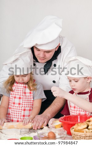 The chef teaches kids to cook - stock photo