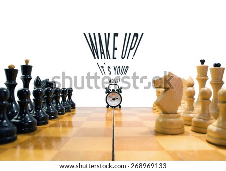 The chess and alarm clock - stock photo