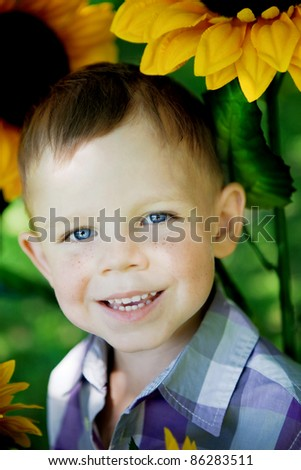 The child, a little boy with blue eyes. - stock photo