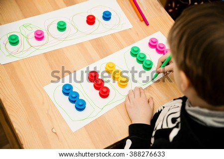 The child develops hand coordination - stock photo