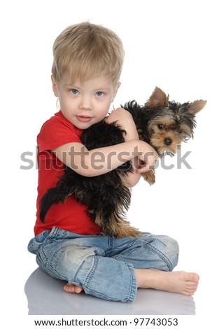 The child embraces a puppy. isolated on white background - stock photo