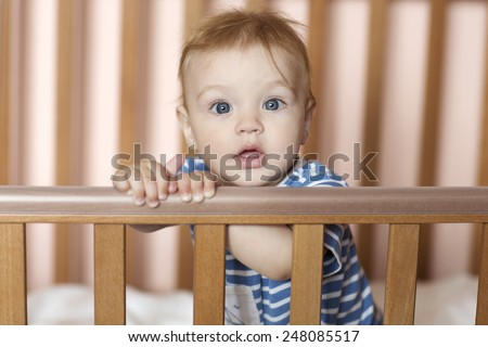 the child in a bed - stock photo