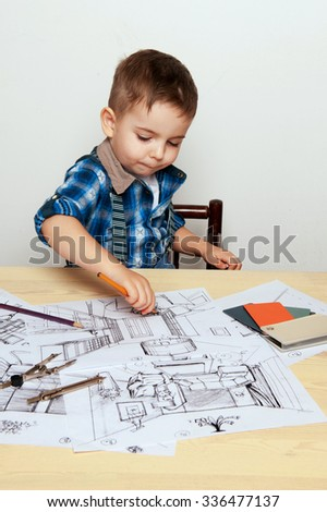the child learns and draws drawings - stock photo