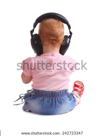 the child listens to music isolated on white background - stock photo