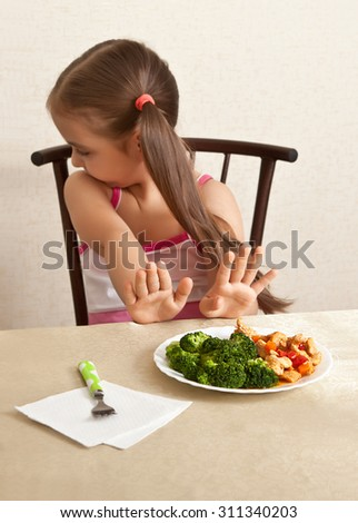 The child refuses to eat - stock photo