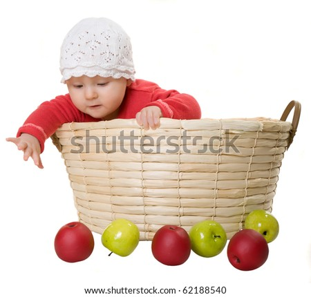 The child sits in a basket. - stock photo