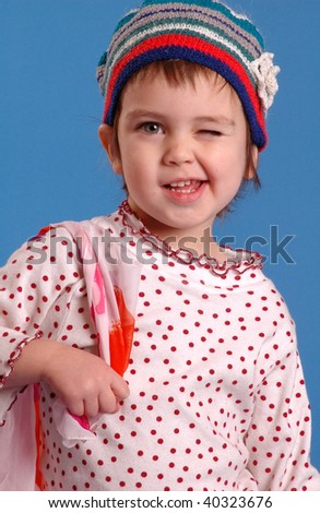 The child wink to somebody - stock photo