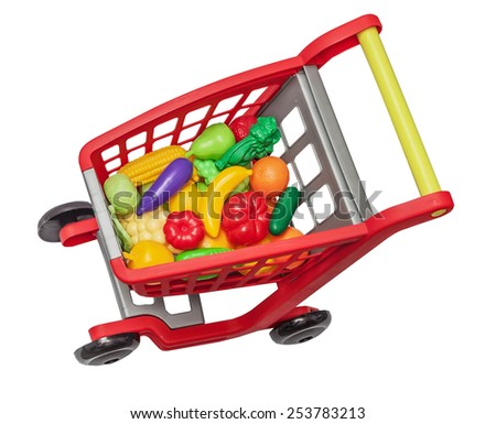 The childish plastic cart with plastic vegetables and fruit, isolated on the white - stock photo