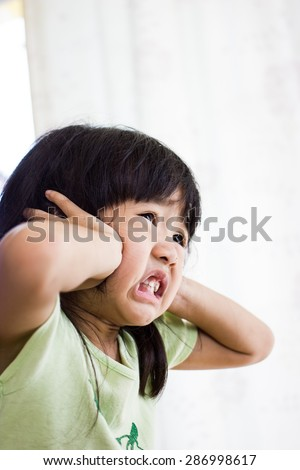 The children to be annoyed by a noise - stock photo