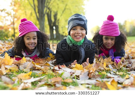 The Childs on the leaf season. The autumn season - stock photo