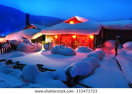The Chinese characteristic farmhouse snowscape,in the night. - stock photo