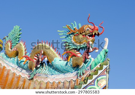 The Chinese dragon on the temple roof. - stock photo