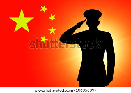 The Chinese flag and the silhouette of a soldier's military salute - stock photo