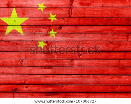 The Chinese flag painted on wooden fence - stock photo