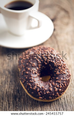 the chocolate donuts and coffee - stock photo