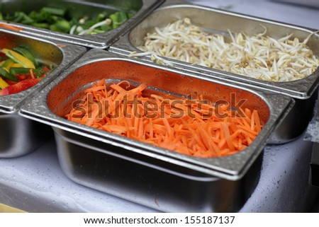 The chopped carrots as ingredients for salad - stock photo