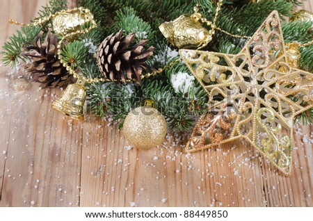 The christmas decorative border on wooden background - stock photo
