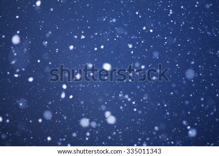 the christmas snowfall in the evening, natural photography - stock photo