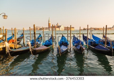 The Church of San Giorgio Maggiore from the San Marco district in Venice with Gondolas in the foreground - stock photo