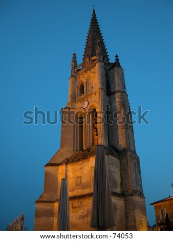 The church tower of Saint Emilion in the Bordeaux region of France: world famous for its red wine - stock photo