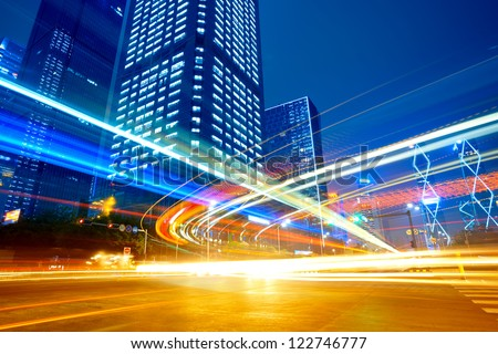 The city and the road at night - stock photo
