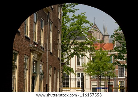 The city Leiden in the Netherlands seen from beneath an arch - stock photo