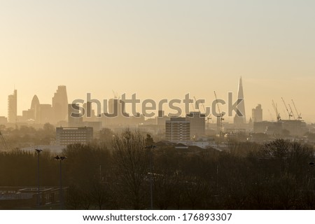 The City of London Cityscape at Sunrise with early Morning Mist from Hampstead. Buildings include the Shard, Gherkin 30 St Mary Axe, St Pauls, Lloyds Building, Stock Exchange and Walkie Talkie.   - stock photo