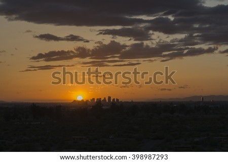 the city of Phoenix silhouette, Arizona, USA from the Hole in the Rock, Papago Park - stock photo