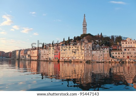 The city of Rovinj on the western coast of Istra peninsula in Croata lit by early morning sun - stock photo