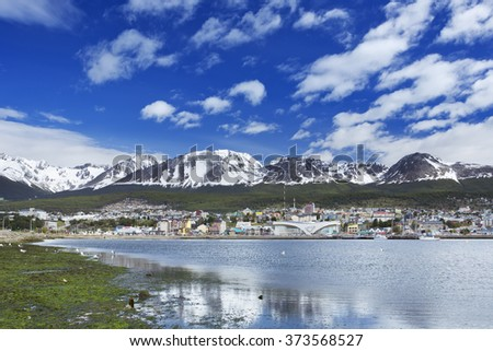 The city of Ushuaia in Argentina, one of the world's most southerly cities, on a sunny day. - stock photo