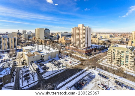 The city skyline of Saskatoon, Saskatchewan in winter on a sunny cold day. - stock photo