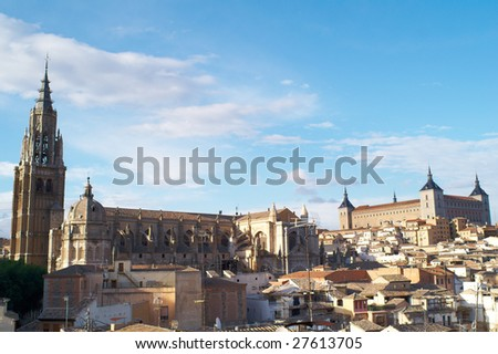 The cityscape of the old Toledo, including Alcazar and Cathedral - stock photo