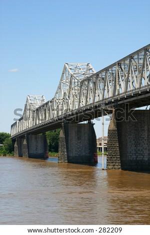 The Clark Memorial Bridge, over the Ohio River, between Kentucky and Indiana - stock photo